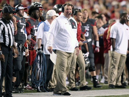 Arkansas coach Bret Bielema looks on from the sidelines during his team's loss to Auburn.