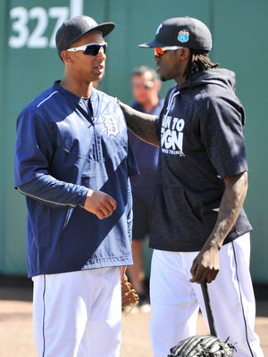 Anthony Gose, left, and Cameron Maybin talk before the Tigers take on the Pirates Tuesday in Lakeland.