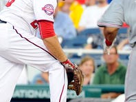 Cincinnati Reds' Eugenio Suarez (7) celebrates his game winning solo home run as he crosses home plate during the eighth inning of a baseball game against the Washington Nationals at Nationals Park, Monday in Washington. The Reds won 3-2.
