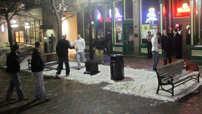 FILE PHOTO: People gather near the Union Bar on the pedestrian mall in downtown Iowa City on Thursday night, Feb. 4, 2010.
