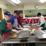 Corning Meals on Wheels volunteers prepare meals in the agency's kitchen Monday.