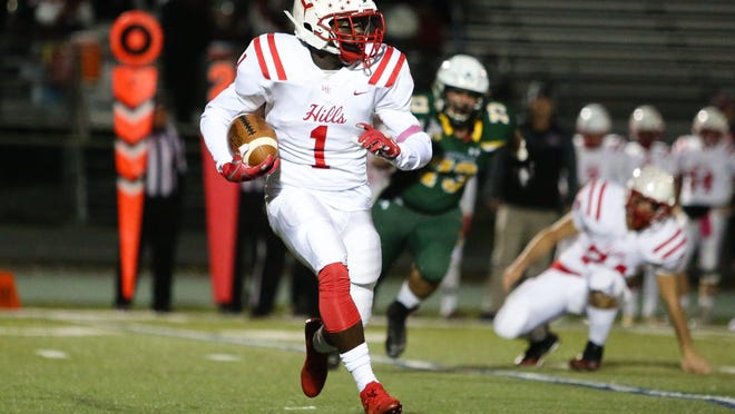 Morris Hills' Joseph Dawson runs the ball during the first half of a football game at Montville High School on October 04, 2019.