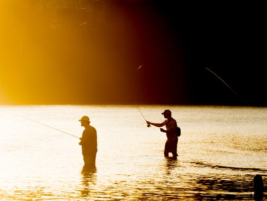 Fishermen cast their lines on the Tennessee River in
