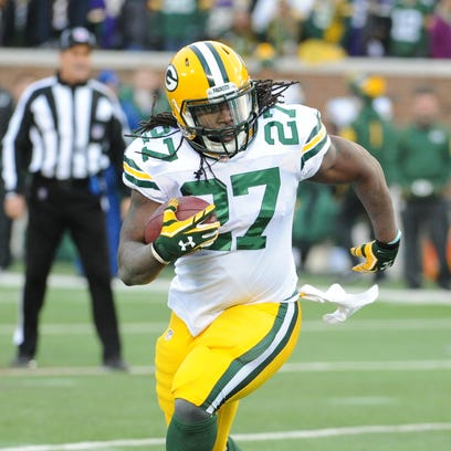 Green Bay Packers running back Eddie Lacy (27) runs the ball against the Minnesota Vikings at TCF Bank Stadium in Minneapolis.