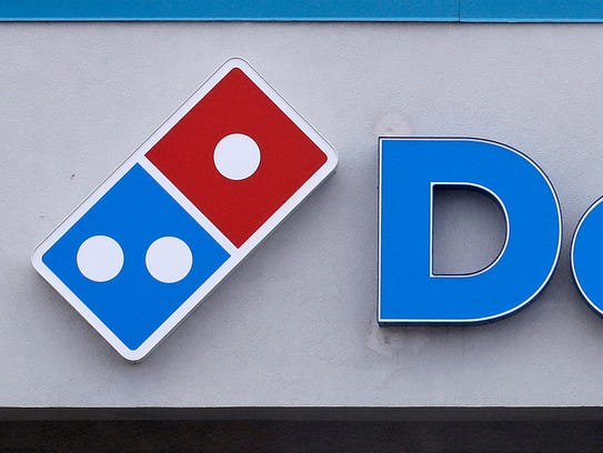 A Domino's Pizza sign is shown in this 2016 Associated