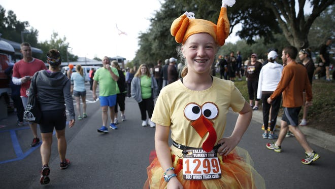 Margaret Harris, 13, wears her turkey costume in preparation for the 40th annual Tallahassee Turkey Trot run on Thanksgiving Day.