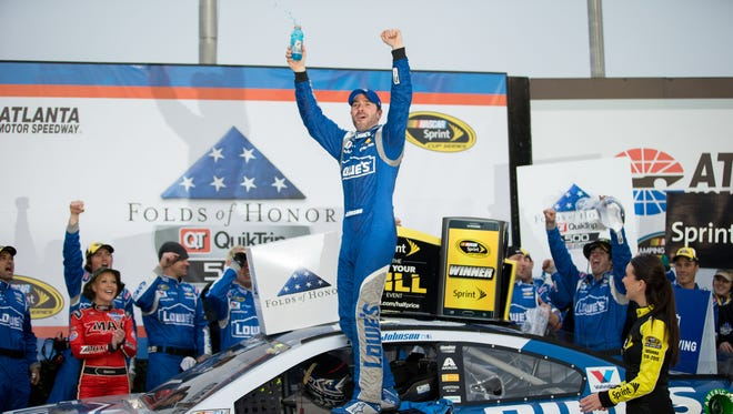 Jimmie Johnson celebrates winning the 2015 Folds of Honor QuikTrip 500 at Atlanta Motor Speedway.