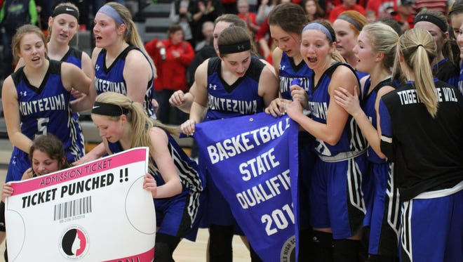 The Class 1A No. 10 Montezuma Bravettes celebrate after defeating the previously unbeaten and No. 3 North Mahaska Warhawks  41-32 in the Region 5 finals, sending the Bravettes into the state basketball tournament which starts Feb. 28 at Wells Fargo Arena in Des Moines.
