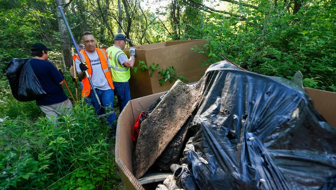 Scenes from the cleanup of the former homeless camp near Kearney Street east of Glenstone Avenue on Saturday, May 19, 2018.