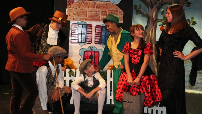 """James (played by Steven George, seated center) finds himself in the middle of many strange adventures in """"James and the Giant Peach."""" The junior musical version of the Roald Dahl book runs July 6 through 21 at Brundage Park Playhouse in Randolph. James' companions are played by (left to right) Arya Mujumdar, Zachary Sussman, Arthav Naidu, Nico Gregory, Charlotte Sussman, and Elizabeth Pietrucha."""