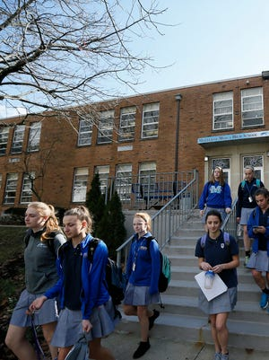 Students exit back stairs after they are dismissed for the day at Mother of Mercy High School in the Westwood neighborhood of Cincinnati on Thursday, March 2, 2017.