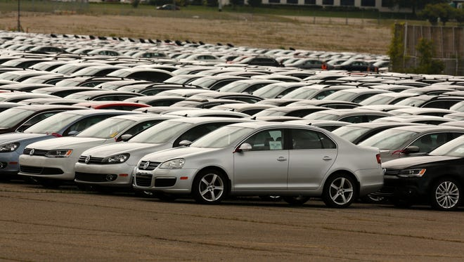 Diesel Volkswagen and Audi vehicles that VW bought back from consumers sit in the parking lot of the Pontiac Silverdome on Aug. 4, 2017, in Pontiac.