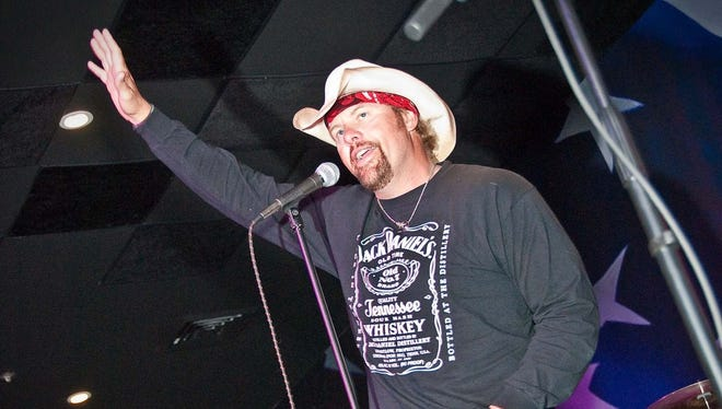 Toby Keith welcomes patrons to grand opening of his bar and grill in Mesa in June 2009. Toby Keith thanks everyone graciously for coming to his newest location at the grand opening of Toby Keith's I Love This Bar & Grill in Mesa on Wednesday, June 3, 2009.