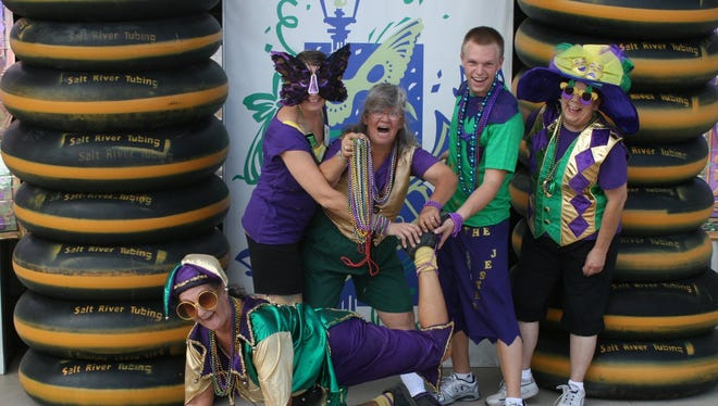 The staff of  Salt River Tubing & Recreation get into the Mardi Gras mood.