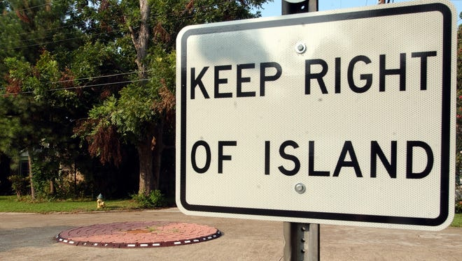 A sign at the intersection of Azalea and St. Joseph streets in Lafayette warns drivers of the upcoming traffic circle.