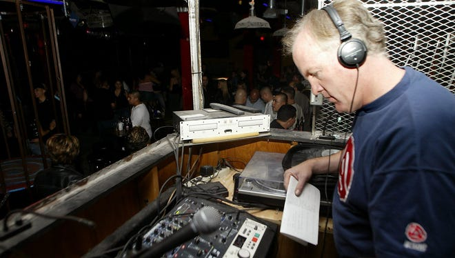 In this file photo, Joe Dorgan, owner of the original Club 101, then located at 500 San Francisco Ave., in the Union Plaza District, is shown in the DJ booth of the popular nightclub that played alternative and retro music. On Sunday, Dorgan will DJ the Ultra Violet New Year's Eve Party at Tricky Falls, 209 S. El Paso St.