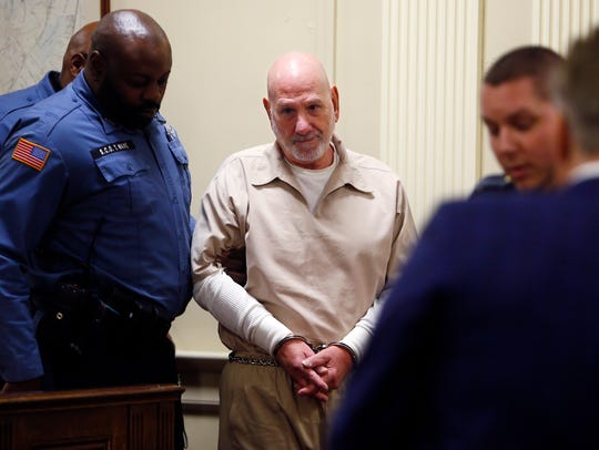 Convicted murderer James Koedatich in led into Morris