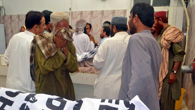 People shift bodies of the victims of a suicide bomb attack that targeted an election campaign rally of Balochistan Awami Party in Mastung, to a hospital in Quetta, Pakistan, on July 13, 2018.