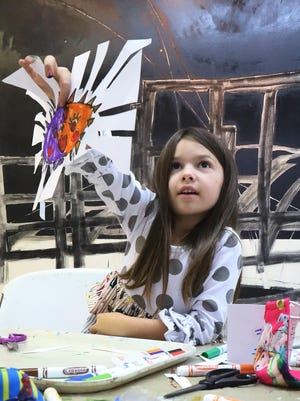 Eleanor McNutt shows off a birthday card she created Monday, Oct. 26, 2020, in the CAE studio. Eleanor is the 5-year-old daughter of Brittany and Kyle Mcnutt of Van Buren.