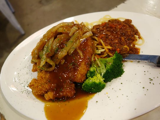 Pork chop and onion with spaghetti from Asian Fusion Cafe.