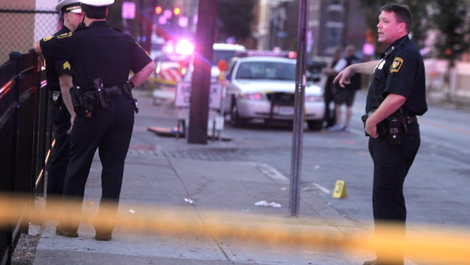 Police investigate a shooting in Over-the-Rhine Wednesday night. A man was shot in the leg and taken to University of Cincinnati Medical Center.