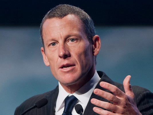 FILE - In this Aug. 29, 2012, file photo, Lance Armstrong speaks to delegates at the World Cancer Congress in Montreal. With a payment and an apology, Armstrong has settled a decade-long dispute with a promotions company that sought repayment of more than $10 million in bonuses it paid the former cyclist during a career that was later exposed to be fueled by performance-enhancing drugs. (Graham Hughes/The Canadian Press via AP, File) MANDATORY CREDIT