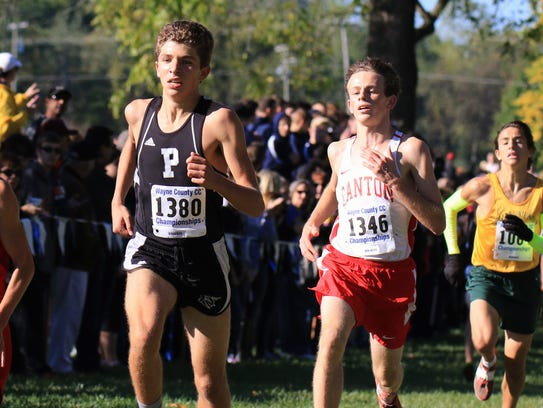 Plymouth's Brandon Boyd (left) races side-by-side with