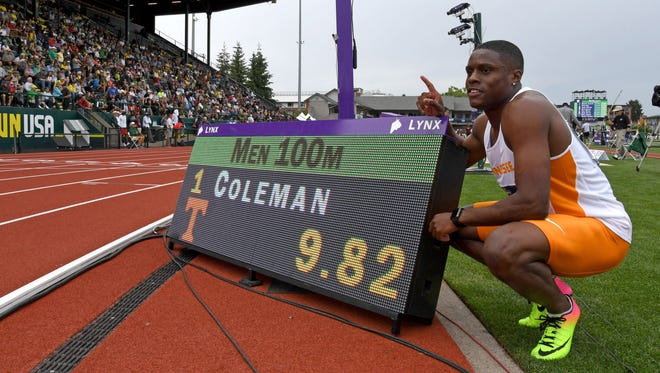 Christian Coleman of Tennessee poses with scoreboard after winning his 100-meter heat in a collegiate record 9.82 seconds.