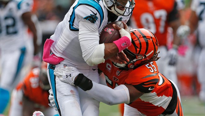 Panthers quarterback Cam Newton rushes for a touchdown as he's brought down by Bengals linebacker Vontaze Burfict on Sunday.