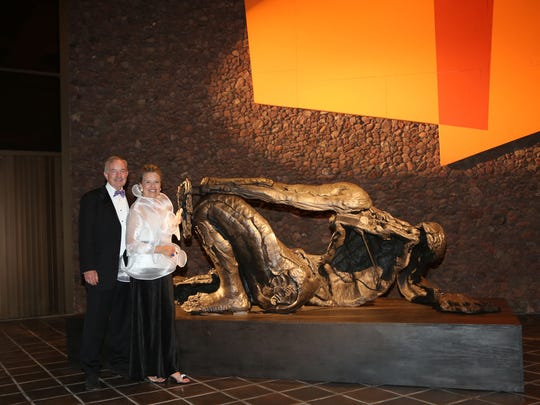 """Dr. Steven Nash and his wife, Carol, in front of the new artwork purchased by museum supporters and the Contemporary Art Council in honor of Dr. Nash. The work, """"Reclining Figure (For Rome)""""by the sculptor Thomas Houseago, is now on display on the Ted Weiner Sculpture Terrace at the front of the museum."""