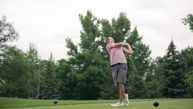 Eric Anderson follows through with his shot during the SouthRidge Golf Invitational on June 25, 2017.