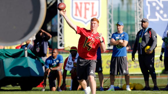 Cincinnati Bengals quarterback Andy Dalton (14) throws the ball during the Pro Bowl Skills Showdown at Wide World of Sports on Jan. 25.