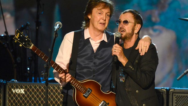 Paul McCartney, left, will induct fellow Beatle Ringo Starr into the Rock and Roll Hall of Fame on April 18 in Cleveland.