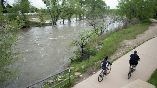 Rainy days have caused high water levels on the Poudre River under north Shields Street near the McMurry Natural Area in Fort Collins May 24. A Natural Areas department environmental planner will go out Saturday morning to share information about restoration work being done on the river, as well as the importance of flood plains.