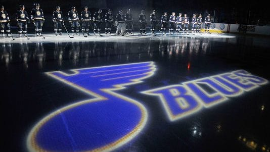 A fan died after falling off an escalator at a St. Louis Blues game.