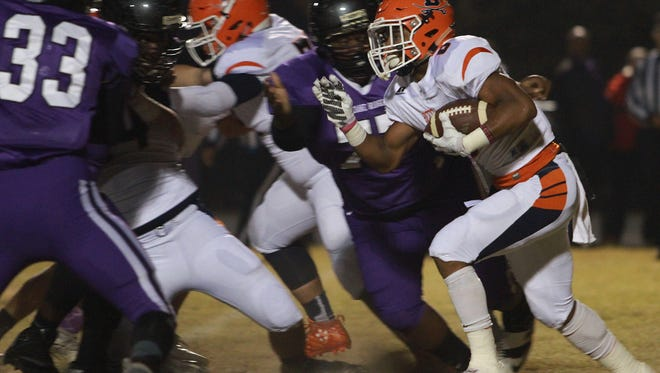 Beech running back Alex Vanzant rushes into the Cane Ridge line during Friday's second-round playoff game. Vanzant rushed for 86 yards on 19 carries.