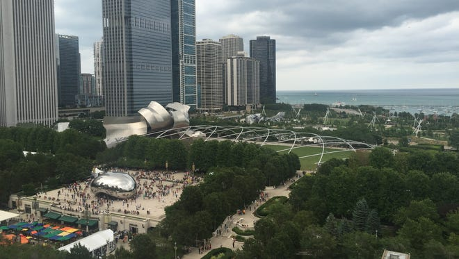 Patrons at Cindy's Rooftop at the Chicago Athletic Association Hotel enjoy views of Millennium Park, the Bean and Lake Michigan.