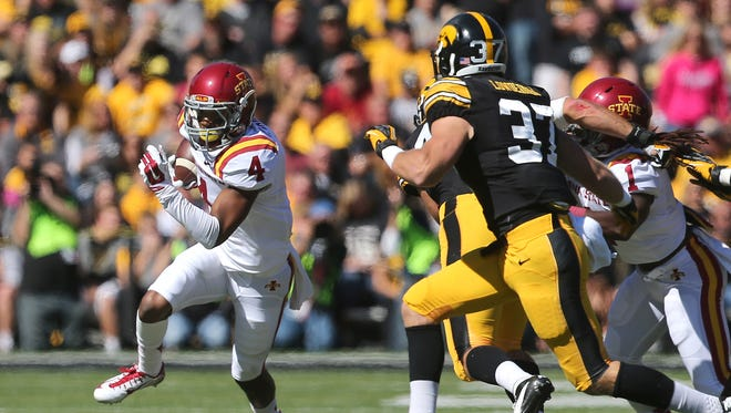 Iowa State receiver P.J. Harris runs the ball against Iowa on Saturday, Sept. 13, 2014, at Kinnick Stadium in Iowa City, Iowa. Harris was charged late TRhursday with aggravated domestic assault/strangulation. He had been kicked off the Cyclones' football team on Jan. 13.