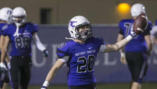 Northwest Christian's Caleb Egherman (20) reacts after a kickoff return for a touchdown against Glendale at Northwest Christian in Phoenix, AZ  on October 16, 2015.