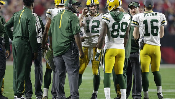 Green Bay Packers quarterback Aaron Rodgers (12) talks