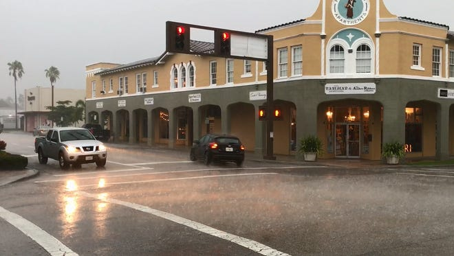 Rain pours down in downtown Vero Beach July 31, 2017.