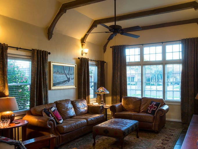 Exposed beams accent the coved, vaulted ceiling in the living room in the home of David Hoffenbacker and Phil Batdorf.