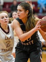 Henderson's Emma Lander looks to pass past defense from Webster's Marissa Austin as the Henderson County Lady Colonels plays district rival Webster County in Dixon Monday, January 23, 2017.