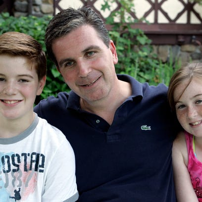 Daniel Nagle of New City, center, with his children