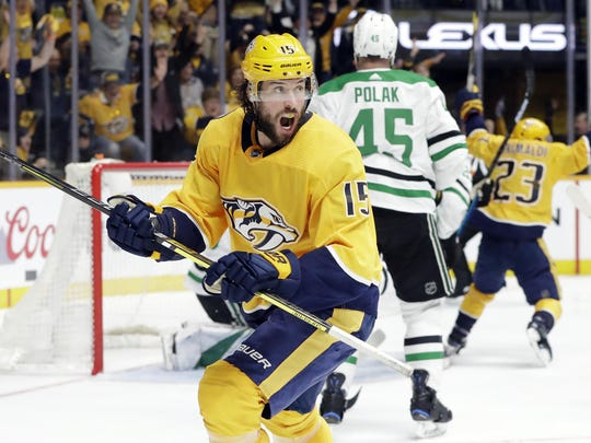 Nashville Predators right wing Craig Smith (15) celebrates after scoring the winning goal against the Dallas Stars in overtime of Game 2 in an NHL hockey first-round playoff series Saturday in Nashville, Tenn.
