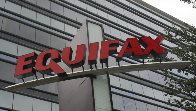 Hackers broke into Equifax?s computer systems in March, gaining access to the data of 143 million Americans.   Mike Stewart/AP This Saturday, July 21, 2012, photo shows signage at the corporate headquarters of Equifax Inc. in Atlanta. A Wall Street Journal report says that hackers broke into Equifax's computer systems in March 2017, giving them time to probe vulnerabilities and eventually gain access to the data of 143 million Americans. The Journal cited a report from security firm FireEye sent to some Equifax customers, including financial firms. (AP Photo/Mike Stewart)