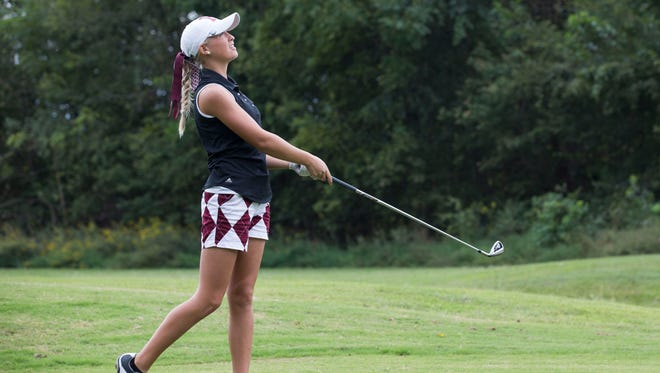 Henderson Count's Payton Carter watches for where her ball is going to land after she teed off during the Girls Second Regional Golf Tournament at Ben Hawes Golf Course in Owensboro.