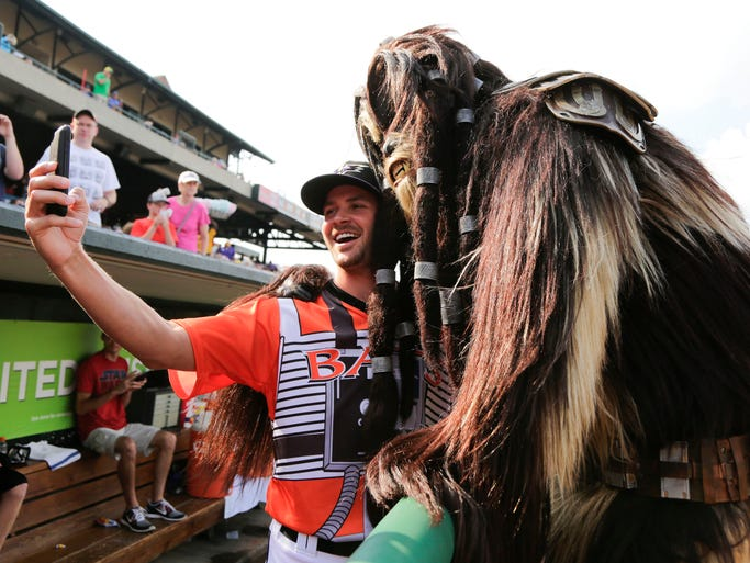 Louisville Bat Justin Freeman takes a selfie with one of the Star Wars character. July 27, 2014
