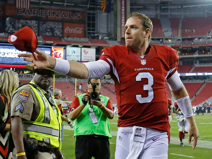 Arizona Cardinals quarterback Carson Palmer leaves the field after the team's loss to the  Cincinnati Bengals in an NFL preseason game, Sunday, Aug. 24, 2014, in Glendale, Ariz.