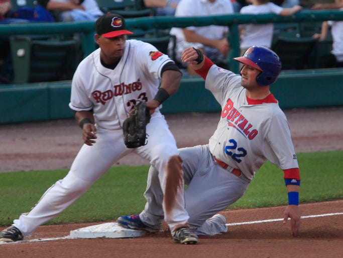 Buffalo Bison #22 Kevin Pillar was safe at third as Red WIngs #23 Deibenson Romero gets the ball early enough to make the throw  to get a runner out at second in the second inning.